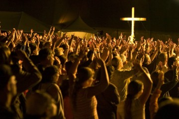 group of people worshiping at night - overcome challenges